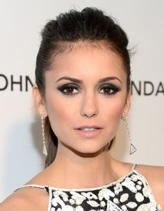 Nina Dobrev Dangling Diamond Earrings - Nina Dobrev looked elegant at a 2013 Oscar party with a pair of triangle cut diamond drop earrings.