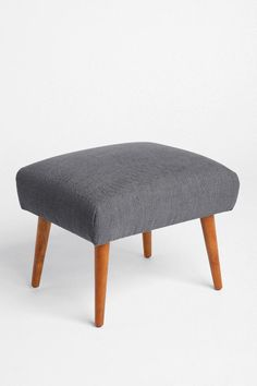 Urban Outfitters Modern Ottoman -- do you like this better than the orange one that matches the chair?? we could do grey or teal or yellow.. thoughts?