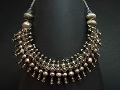 A simply awesome old Kuchi silver choker from Afghanistan. It features silver beads showing a remarkable work and very original. Very elegant and balanced. The Kuchi people, from the Persian -koch- meaning migration, are Afghan pashtoons nomads divided in a number of tribes that inhabit areas of Afghanistan and, to a lesser extent, Pakistan. Their jewellery is quite often very colourful using silver, glass and, in some fewer cases, enamel. Early XXth century.