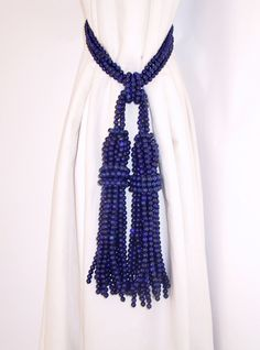 Semi precious beads fashioned into  tieback with 2 tassels.