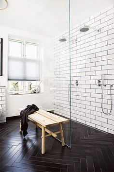 MASTER BATH: LOVE this idea: clear floor-to-ceiling glass wall separates walk-in shower from vanity area (especially good for a small master) + contrasting bright wall tile and dark floor tile + rando bench for throwing towels, clothes, toiletries, asses + plenty of natural light, which is bounced around by bright colors, mirrors, and clear glass