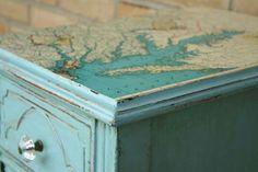Decoupaged map on dresser top or desk top