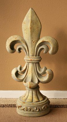 This finial lives on a silver demilune table under a vintage eiffel tower print