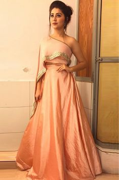 The Stylish And Elegant Lehenga Choli In Peach Colour Looks Stunning And Gorgeous With Trendy And Fashionable Embroidery .The Art Silk Fabric Party Wear Lehenga Choli Looks Extremely Attractive An. Indian Wedding Gowns, Indian Gowns Dresses, Pakistani Dresses, Wedding Dresses, Pink Gowns, Wedding Themes, Gown Dress Party Wear, Party Wear Lehenga, Designer Party Wear Dresses