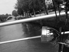 Leidserijn Canal, De Meern - Crossing the canal and bike lamp reflection