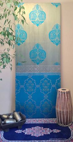 I was inspired by a gorgeous silk sari to paint this door with stencils in a sari pattern. This would be gorgeous on an accent wall. I show you how to do it at Paint+Pattern.