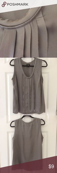 "NWT Dark Silver Sleeveless Pleated Front Silky Top Feminine sleeveless top NEW with tags  Looks great under jacket or by itself  Beautiful dark silver/gray satiny material with front pleats, raw edge neckline  Pit to pit: 20"", length 26""   100% polyester Mossimo Tops"