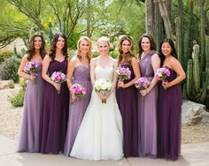 Bride and Bridesmaids in Dresses in Shades of Purple Photography: Jennifer Bowen Photography Read More: http://www.insideweddings.com/weddings/charming-desert-wedding-featuring-bright-berry-tones-in-arizona/759/