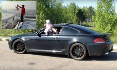 Russian dad dangles baby out of BMW window while driving | Daily Mail Online