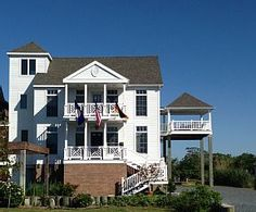 The Moorings North: Chincoteague Island, VA. The house is elegantly decorated and has mesmerizing panoramic views of Chincoteague Bay. Looking For Houses, Chincoteague Island, Vacation Places, Vacation Rentals, Waterfront Homes, Common Area, Beach Chairs, Beautiful Homes, Mansions