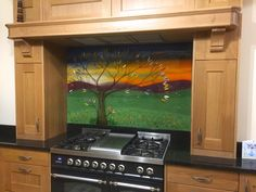 Delivered to a home in Great Ecclestone, this beautiful fused glass art is a splashback proudly bearing a twist on our classic Tree of Life design. A bright sunset in blazing orange matches vivid green grass below, while hand cut leaves decorate the tree with a huge range of complementary colours. The piece perfectly matches the alcove, snugly fitting behind the cooker. Life Design, All Design, Fused Glass Art, Panel Art, Colours, Splashback, Green Grass, Architecture, Alcove