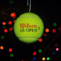 Tennis ball ornament -drill small hole into ball -poke paper clip in -hang -mine lasted pretty well outside