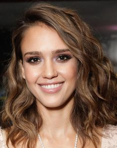 Jessica Alba Shoulder Length Wavy Hairstyle--If you want to style this look, you can enhance your own natural waves and curls with products from the Aussie 'Sprunch' collection. This is a great shoulder length hair style for longer face shapes because the side part and falling bangs balance and minimizes the length.