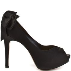 Elegance and sophistication will be yours when you slip on these gorgeous pumps from Le Soir by Pour La Victoire.  Cristella 2 features a black satin upper with a feminine bow at the back of the heel. This pretty peep toe has a 1 inch platform and 4 inch heel to create the perfect look for your next fancy occasion.