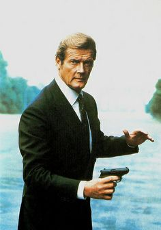 Roger Moore in A View to a Kill. Dutch postcard by Loeb Uitgevers BV, Amsterdam. Photo: Eon Productions / Gilrose Publications / Danjaq S.A. Publicity still for A View to a Kill (John Glen, 1985).
