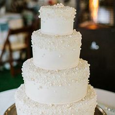 Pearl-Inspired Cake | Southern brides love their pearls! Clusters of edible white beads make this cake a showstopper. | SouthernLiving.com