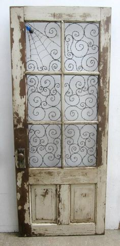I love this door. Barbed wire where the glass used to be. Beautiful. From Dusty Raven Gallery. https://www.facebook.com/TheDustyRavenGallery