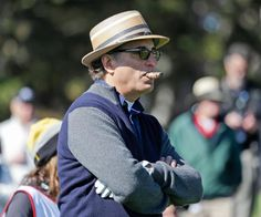 Actor Andy Garcia puffs a cigar on the third green of the Pebble Beach Golf Links. (Eric Risberg/AP)