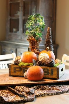 Love this fall tablescape combining vintage, and seasonal decorations.