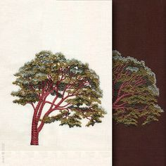 Tree by Anali is embroidered on natural white and chocolate linen towels.