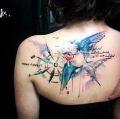 watercolor bird and compass tattoo