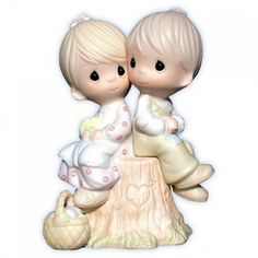 A classic. The concept of simply loving one another speaks volumes. This figurine depicts a boy and girl sitting on a stump. This figurine is one of the original twenty-one and stands 4.75 inches tall