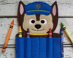 CRAYONS ARE NOT INCLUDED !!!!  Felt Crayon Holder  Holds six regular sized crayons.  Made out of felt on an embroidery machine.  Approx. size is 5 x 7 inches.  CRAYONS ARE NOT INCLUDED. They do no ship well.