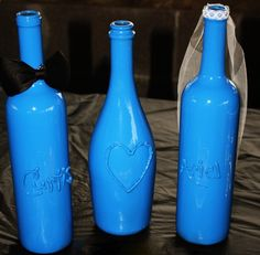 This is so easy to make! just write whatever you want on a wine bottle, using a hot glue gun, and spray paint over it. We could do dark blue, black, or emerald