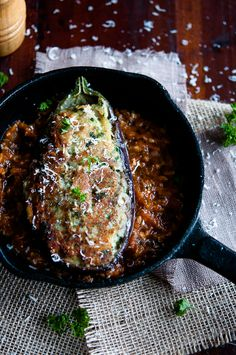 Cheese stuffed eggplants with hearty tomato sauce
