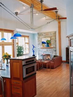 wood cabinets with wood floor and ceiling Eclectic Kitchen, Eclectic Living Room, Living Room Wood Floor, Built In Ovens, Banquette Seating, Cottage Plan, Wood Ceilings, Loft Spaces, Wood Cabinets