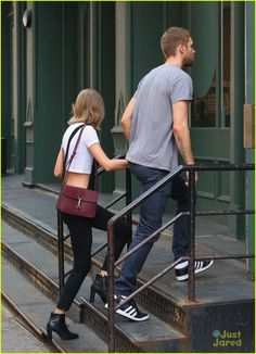 Taylor Swift and her boyfriend Calvin Harris hold hands while leaving the Spotted Pig restaurant on Thursday afternoon (May 28) in New York City.