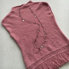 "Pretty pink sweater with fringe Super soft and pretty sleeveless sweater. Slight funnel neck, and fringe. Pre loved  but has a boucle' knit look. Lightweight for the spring. Says medium but probably fits like a small. Bust 151/2"", length 23"". Acrylic, Nylon/spandex. To the Max Sweaters"