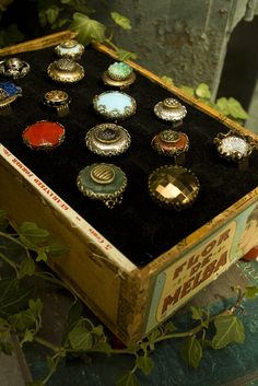 A vintage Cigar box reused as a decorative ring display! How cool is that?