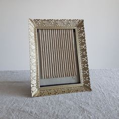 """5"""" x 7"""" Brass / gold-tone metal picture frames w. ornate floral design // Hollywood regency photo frames, family heirloom photos, 13 x 18 cm by BlueChickenVintage on Etsy"""