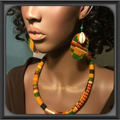 1 of 2: African Kente Print Fabric And Cowry Shell Earrings                                                                                                                                                      More