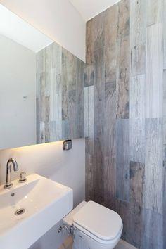 Casa C Puerto Roldan: Baños de estilo moderno por VISMARACORSI ARQUITECTOS