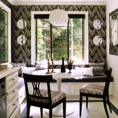 built-in banquette, steel windows...I'd lose the zig zag wallpaper (design by Mary McDonald, photo by Tim Street-Porter)