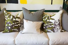 Well-Arranged Sofa Pillows - Idea House Family Room by Bill Ingram - Southernliving. A mix of pillows in different fabrics, patterns, and sizes elevates this simple white couch from Serena and Lily. The leafy, rich pillow fabric nicelycomplements the botanical art on the opposing wall. Pinstripe pillows add further texture, and pick up on the tented ceiling's graphic Greek Key trim.