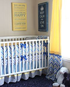 beautiful blue and yellow color palette and loving that chevron crib bedding! #nursery #chevron