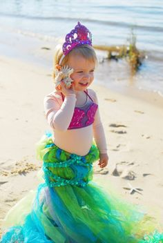"""old pair of tights (Be sure they still fit your child in the waist.) 2 rolls (6-inch wide) glittered aqua blue tulle 2 rolls (6-inch wide) glittered lime green tulle 1 to 1 1/2 yards stretch sequin trim 1 (8 ½"""" x 11"""") sheet purple felt 1 (8 ½"""" x 11"""") peel-and-stick glitter foam safety pin or hot glue gun hole punch 1 roll (3/8-inch thick) purple glitter ribbon glitter puff paint, if desired"""