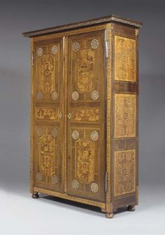 A LOUIS XIV PEWTER-INLAID PALISANDER, FRUITWOOD AND FLORAL-MARQUETRY ARMOIRE