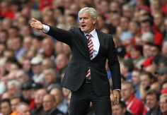 FA charges Hughes with misconduct = The English Football Association is charging Stoke City manager Mark Hughes with improper conduct for his outburst at the fourth official over the weekend.  Hughes went off at the fourth official in the 34th minute after.....