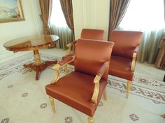 Lot 308 - A set of three parcel gilt Neoclassical Fauteuils, with wide seats, fluted legs and padded