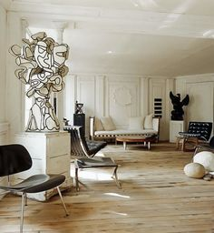 SCANDINAVIAN COLLECTORS - Parisian interior of Frederic Mechiche: Jean Dubuffet black and white sculpture (c.1960s), other artworks by Joseph Beuys, Pierre Soulages and Cesar & Jean Arp. Barcelona-lounge chair by Mies van der Rohe (1928) and a coffee table by Isamu Noguchi (1944).