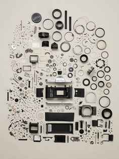 A disassembled Pentax Camera via thingsorganizedneatly-this would be a great print for my office.