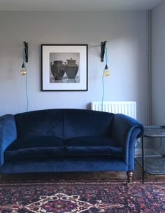 Navy blue velvet sofa. Persian rug. Sitting room. Lounge. Dulux Night Jewels 5 grey paint.