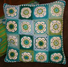cushion with a traditional granny square on one side and African flower squares on the other side