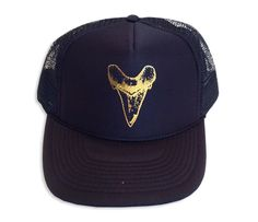 trucker cap with a gold foil shark tooth - rebecca beach