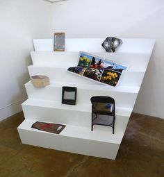 Now Featuring Emma Spertus Paper Plane, Exhibit, Kitsch, Floating Shelves, June, Windows, Spaces, Cabinet, Landscape
