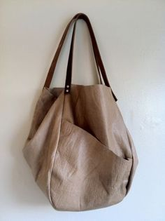 Hawke and Carry Large Asymmetrical Leather Bag.